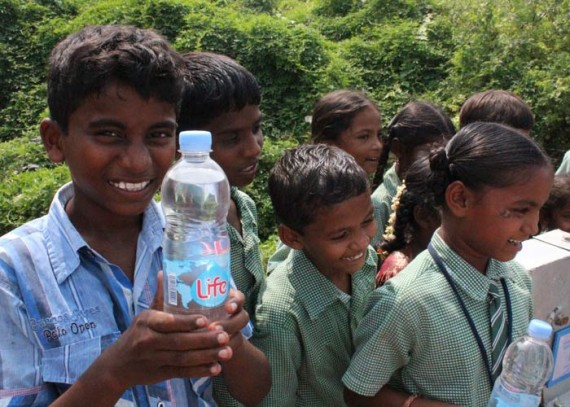 The children of Rajavaram enjoy Life water along with their well