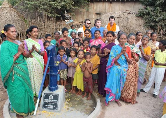Simon, Sam & Lucas with the Balarampuram community sponsored by Life water