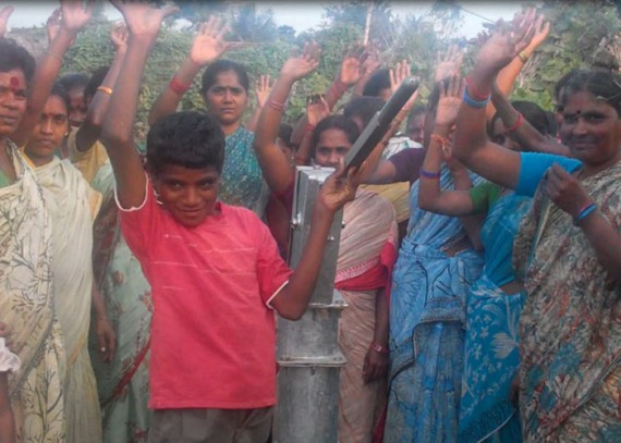 The Maithiri community with their new well