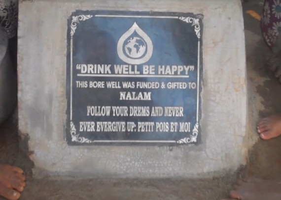 A close-up of the plaque on the well