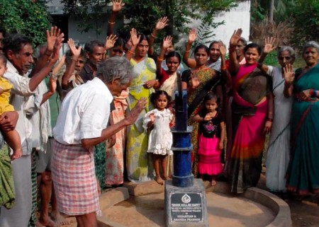 The Yeguva Darapelle community with their new well