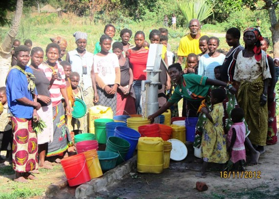 The Bombwe community with their new well