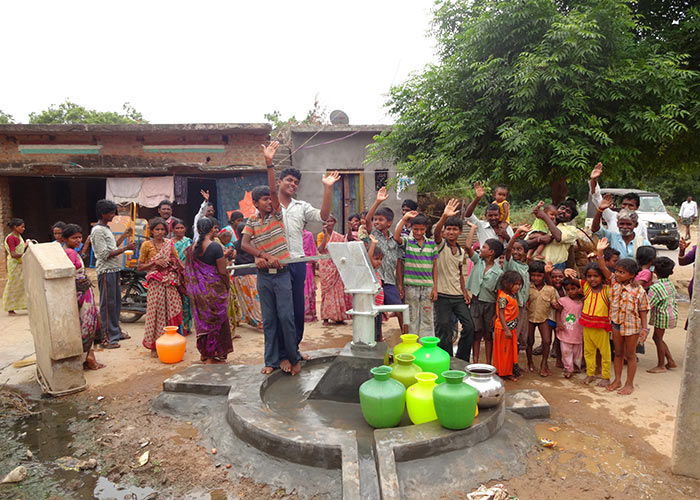 The Ambedkar Nagar community with their new well
