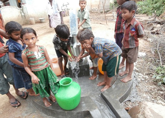The children of Arogya Nagar with their new well