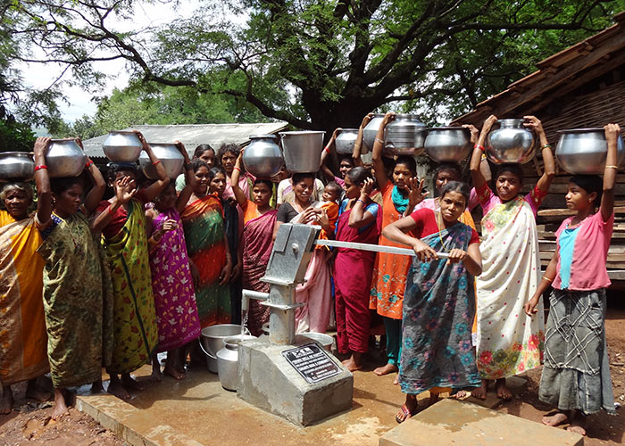 Members of the Ganjayeguda community celebrating their new, protected water source
