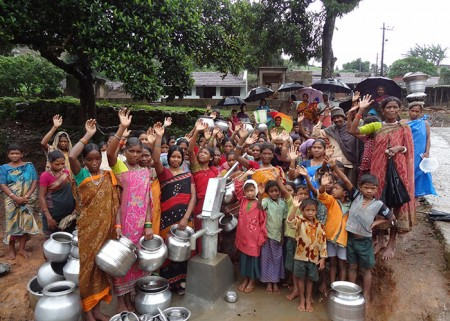 Members of the Gorapur community celebrating at their newly protected water source