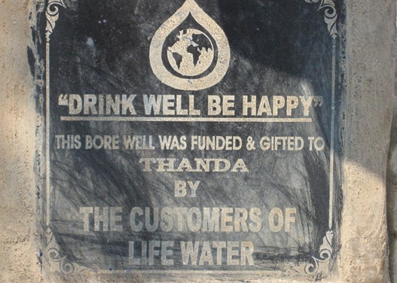 A plaque on the well commemorates the contribution made by Life Water customers