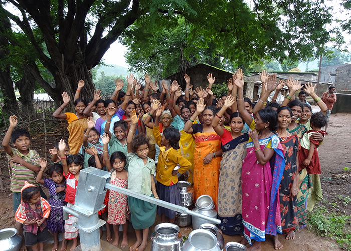 Members of the Kondrome community celebrating their new protected water source