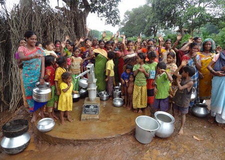 The Karakavalasa community with their new well
