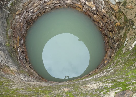 Old water source: a cloudy, unprotected well