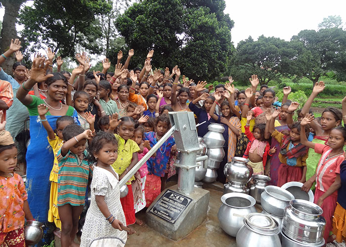 The Manjugada community celebrating their fresh, new, clean water source in the heart of their community