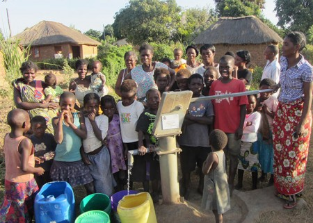 The Mwenge/Bwacha community with their new well