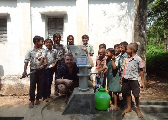 Sam, drop4drop charity co-ordinator, at the well dedicated to his Dad