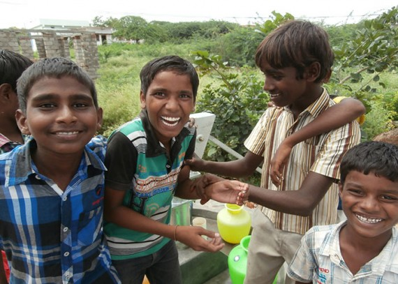 The children of Zinkalnagar B. Mattam with their new well