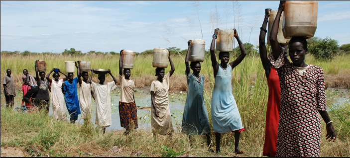South Sudan Women Carrying Water