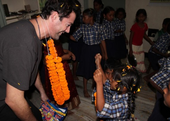 Lucas White, co-founder of Life water, receiving a warm welcome into the community
