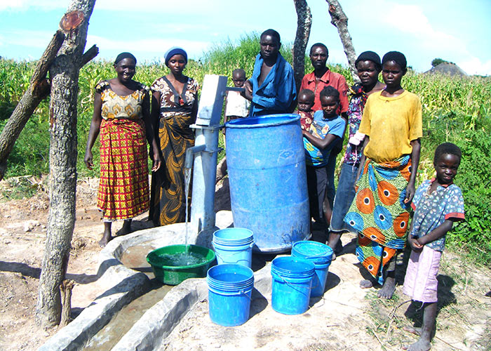 The Namonica community with their new well