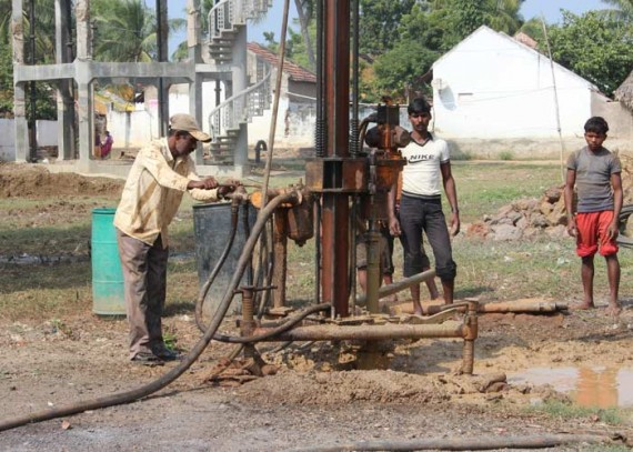 A new borewell is drilled in the centre of the community, a few metres from the empty water tower