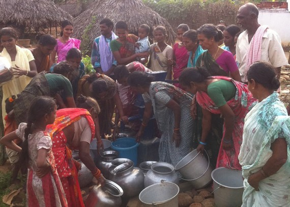 The Daduvu community collecting water from their new well