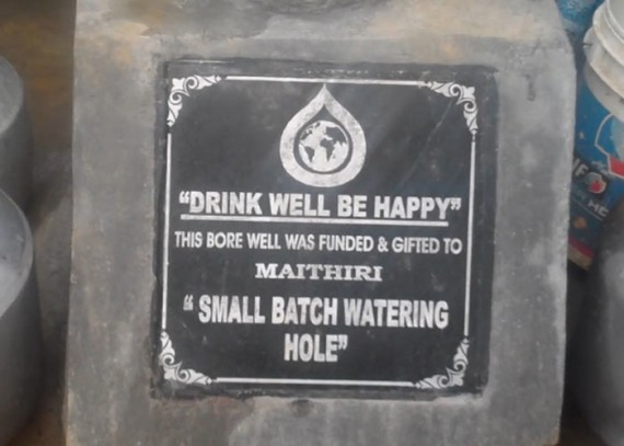 Close up of plaque on well