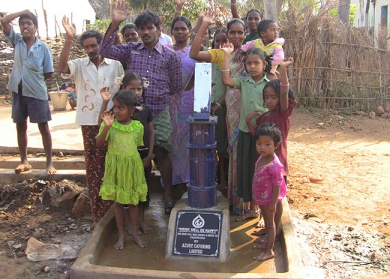 The people of Parupaka with their new well
