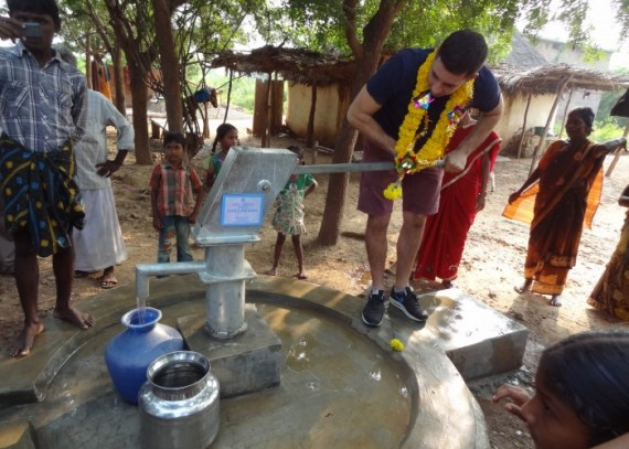 Siddugaripalli well donor Elliot Gleave using the well