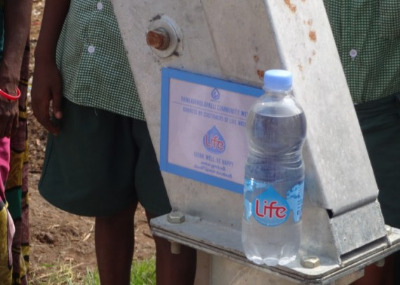 A plaque on the well commemorates the people who made this project possible through their purchases of Life water