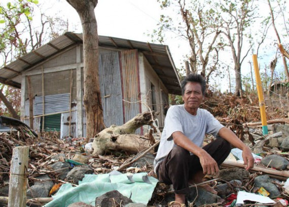 Philippines 2013 Hurrican Haiyan Sefin Arabaca outside his destroyed house