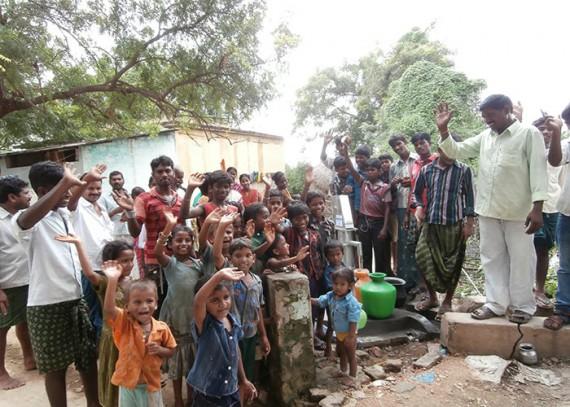 The Arogya Nagar community with their new well