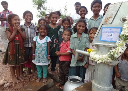 Children celebrating their new water source at the Infinity Foods well