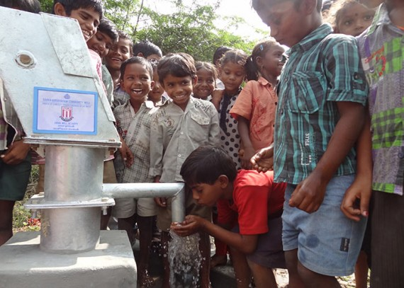 Beneficiaries enjoying their fresh clean water source close to their homes