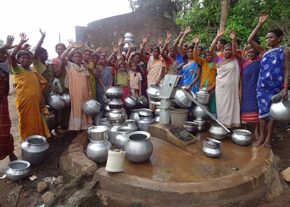 Members of the Gogudu community at their newly protected water source