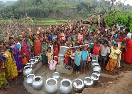 The Kusuma Guda community celebrating their new well thanks to XL