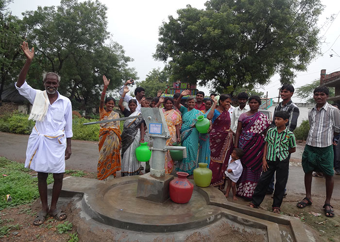 The Mallepalle community with their new well
