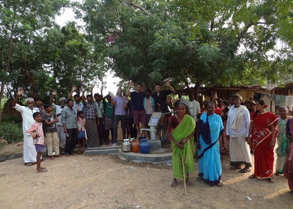 Elliot, Lucas and Sam with the Siddugaripalli community and new well