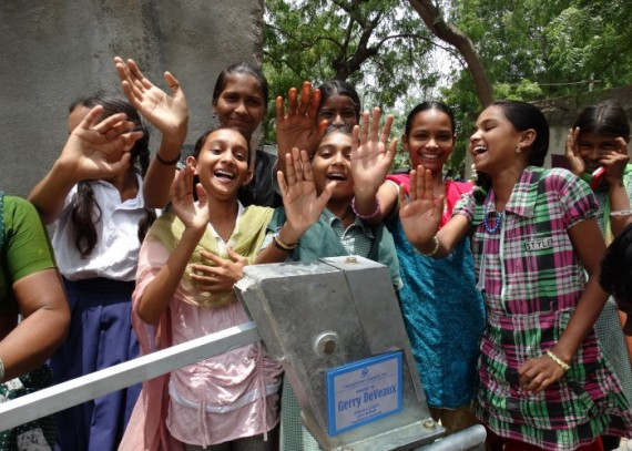 Children celebrating their new water source