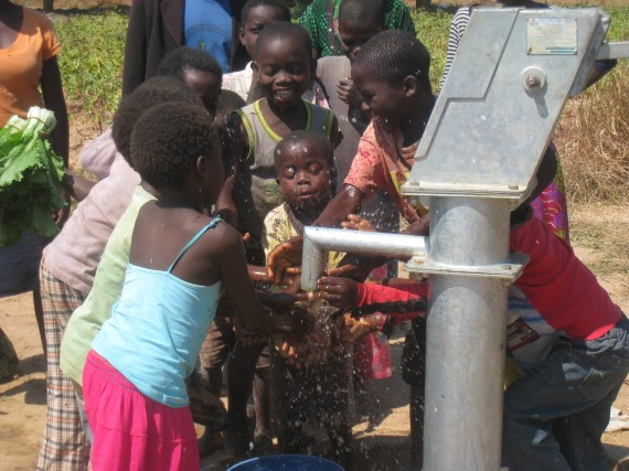 Zambian children play with their new well insalled by drop4drop in 2013