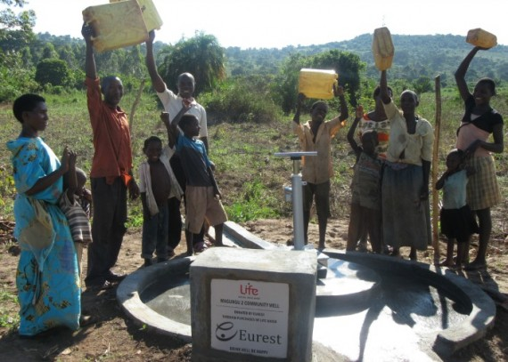 Community members rejoicing at their newly constructed water source