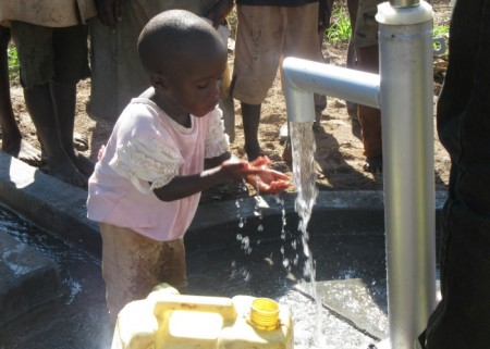 Joshua aged 4 years enjoying clean water